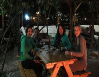Jessie, Ali (pension co-owner), Eve and Caroline enjoying a few wines after dinner at Saban Pension