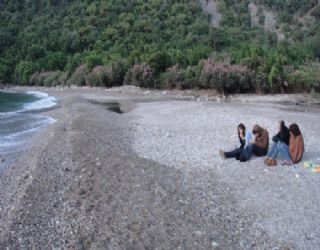 Jane, Rob, Scottie and Charlotte looking cold and miserable on Olympos beach during our painful wait for the sunrise after a long night out